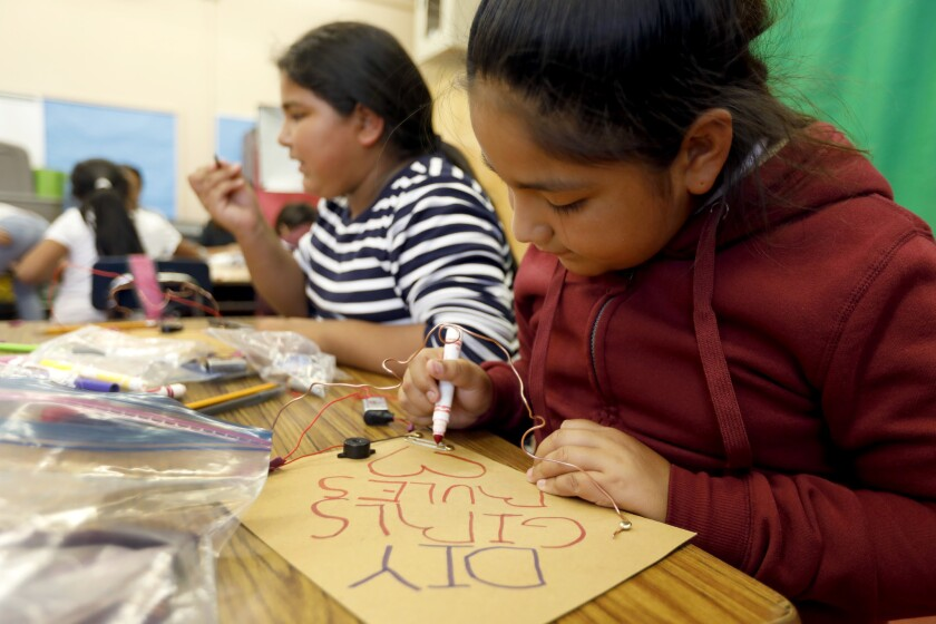 Judith Ayala, 10, and other classmates prepare for an experiment in the Do It Yourself Girls program at Telfair Elementary School in Pacoima.