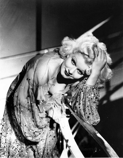 Blond-haired beauty Jean Harlow made a name for herself as a silver-screen sex symbol during the 1930s. Health problems cut her life short at age 26, but in her near-decade on screen, she received critical acclaim for her alluring and comedic roles, making a slate of films including three with Spencer Tracy and six with Clark Gable. She was the first blond bombshell, setting the mold for the likes of Jayne Mansfield, Lana Turner and Marilyn Monroe.