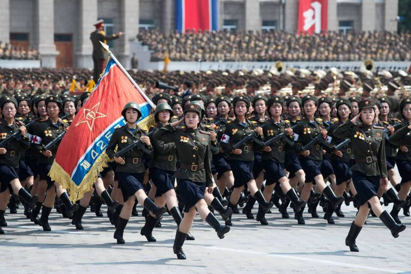 North Korean soldiers march during a military parade past Kim Il Sung Square in Pyongyang on the 60th anniversary of the Korean War armistice.