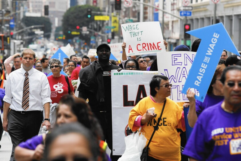 Worker wages will get an additional boost from higher minimum wages taking effect in several cities and states. Above, demonstrators in L.A. in May push for a higher wage floor.