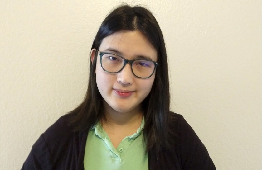 This photo provided by Lisa Danz shows Sophie Zhang. Zhang worked as a low-level Facebook data scientist nearly three years before was she fired in the fall of 2020. On her final day, she posted a 6,600-word memo to the company's internal forum — a common practice for departing employees. In the memo, first published by Buzzfeed, she outlined evidence that governments in countries like Azerbaijan and Honduras were using fake accounts to influence the public. (Lisa Danz via AP)