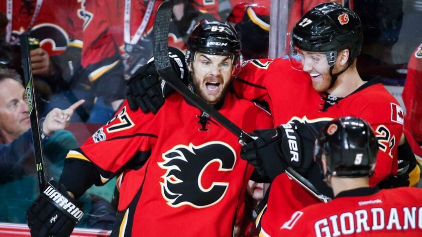 The Calgary Flames' Michael Frolik, left, celebrates his goal with teammate Dougie Hamilton during the first period against the New York Islanders on March 5.