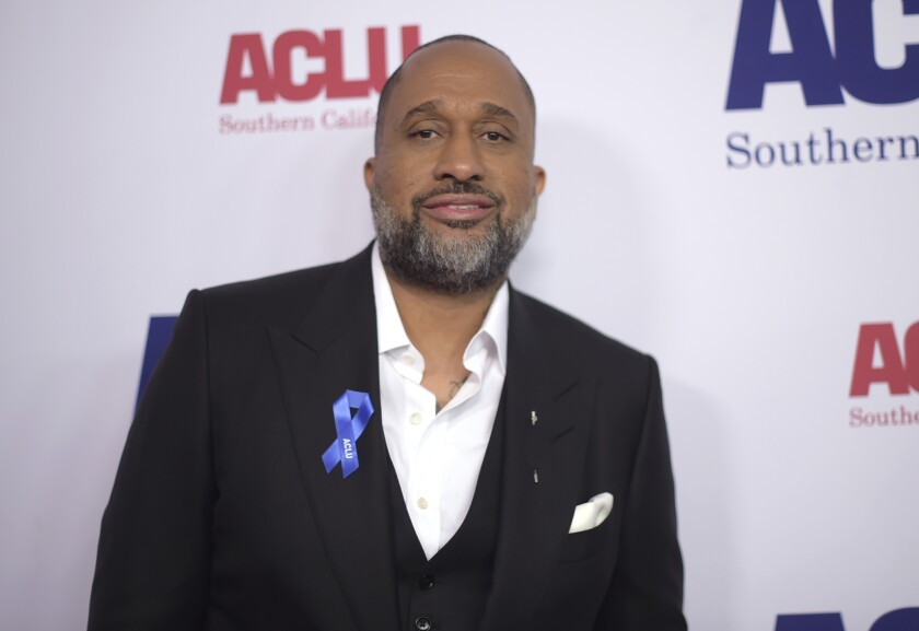 """FILE - Kenya Barris, series creator of """"black-ish,"""" arrives at the ACLU SoCal's Bill of Rights Dinner on Nov. 11, 2018, in Beverly Hills, Calif. A politically charged episode of """"black-ish"""" from 2017 that was shelved by ABC has found a home on the streaming service Hulu. (Photo by Richard Shotwell/Invision/AP, File)"""