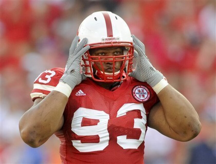 In this Sept.. 5, 2009, file photo, Nebraska's Ndamukong Suh looks on during an NCAA college football game against Florida Atlantic in Lincoln, Neb. The man who started the season with the hard-to-pronounce first name has turned into a household name in college football. Suh is in line to possibly becoming only the second defensive player to ever win the Heisman Trophy. (AP Photo/Dave Weaver)