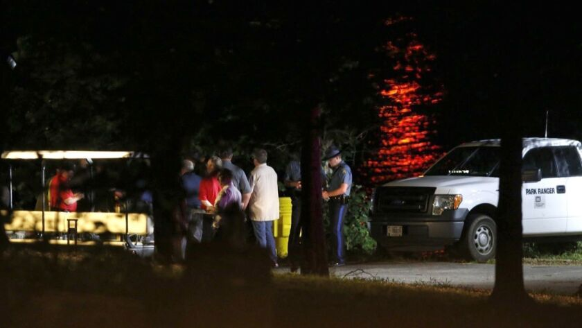Rescue crews work at the scene of a deadly boat accident at Table Rock Lake in Branson, Mo., Thursda