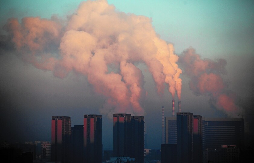 A thermal power plant discharges heavy smog into the air in Changchun, in northeast China's Jilin province, on Jan. 22, 2013.