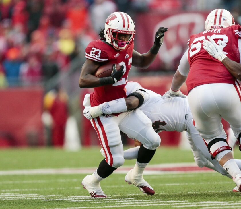 Rutgers Kaiwan Lewis tackles Wisconsin running back Dare Ogunbowale (23) during the first half of an NCAA college football game Saturday, Oct. 31, 2015, in Madison, Wis. (AP Photo/Andy Manis)