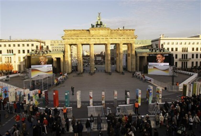 Dominoes stand in front of the Brandenburg Gate in Berlin, Germany, Saturday, Nov. 7, 2009. Around 1,000 dominos were placed on the former border near the Brandenburg Gate for the Festival of Freedom on the 20th anniversary of the fall of the Berlin Wall on Nov. 9, 2009 and will collapse during the commemoration event. (AP Photo/Herbert Knosowski)