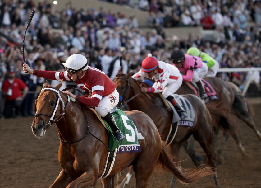 Florent Geroux, left, rides Gun Runner to victory in the Classic horse race during the Breeders' Cup