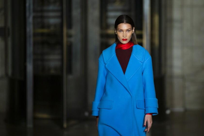 The Oscar De la Renta collection is modeled by Bella Hadid during Fashion Week, Monday, Feb. 10, 2020, in New York. (AP Photo/Eduardo Munoz Alvarez)