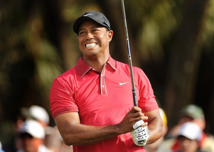 Tiger Woods grimaces as he follows through on his tee shot during the WGC-Cadillac Championship on March 9 in Doral, Fla.