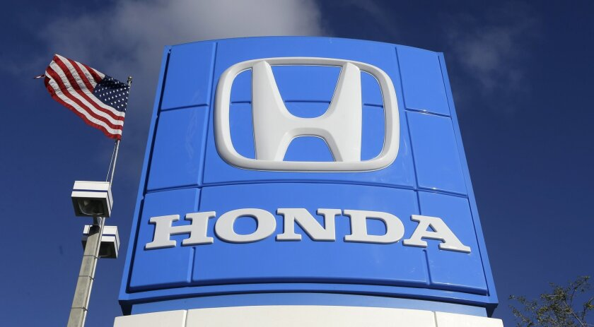 FILE - This Tuesday, Jan. 13, 2015, file photo shows a sign at a Honda dealership in Miami Lakes, Fla. If you're in the market for a Japanese car, March is a good time to buy. Unlike U.S., European and Korean automakers, which end their financial year on Dec. 31, Japanese companies like Toyota Motor Corp. and Honda Motor Co. close their books on March 31. (AP Photo/Alan Diaz, File)