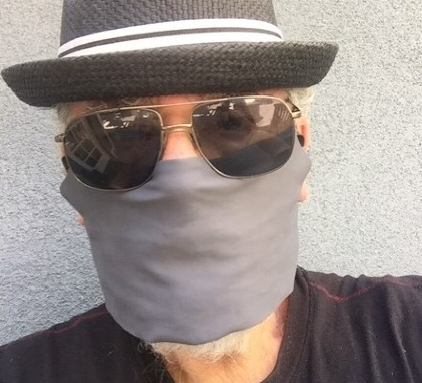 Jocko Marcellino, leader of Sha Na Na, wears a face mask that inspired his latest song.
