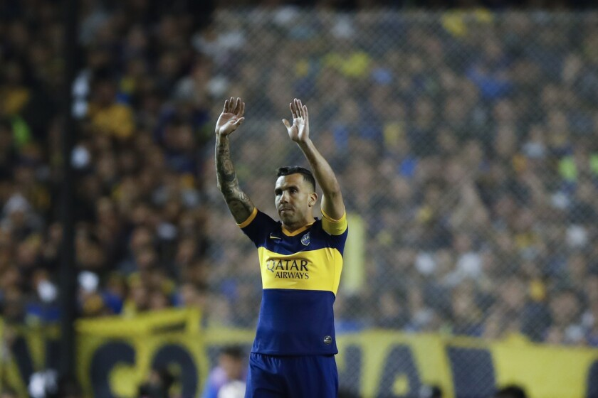 FILE - In this Oct. 22, 2019 file photo, Carlos Tevez of Boca Juniors, waves prior to the Copa Libertadores semifinal second leg soccer match against River Plate, at La Bombonera stadium in Buenos Aires, Argentina. Tevez in a press conference on Friday, June 4, 2021 announced his departure from the team. (AP Photo/Natacha Pisarenko, File)