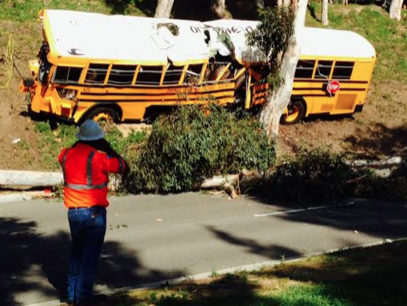 A school bus with 11 students and a driver crashed in the Anaheim Hills, leaving six people injured, officials say.