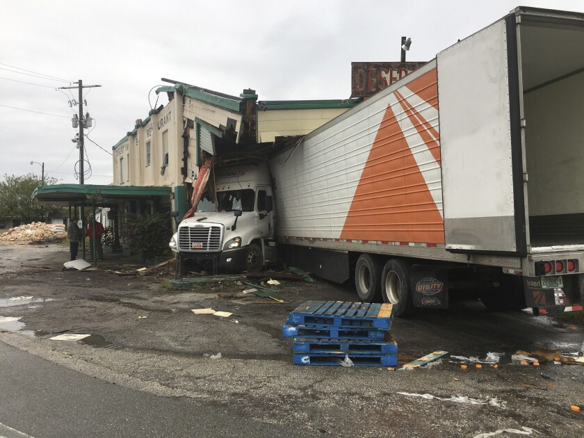 In a photo provided by the Florida Highway Patrol, a semitruck plowed into the historic Desert Inn in Yeehaw Junction south of Orlando, Fla., early Sunday, Dec. 22, 2019, causing major damage but no apparent injuries. The inn is the centerpiece of Yeehaw Junction, a tiny respite off Florida's Turnpike between South Florida and Orlando. (Florida Highway Patrol via AP)