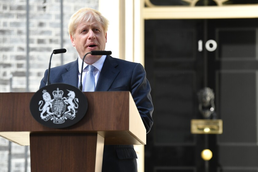 Boris Johnson arrives at 10 Downing St. to take office as British prime minister