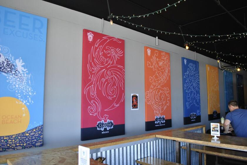 The tasting room's art features outline-type drawings of mythical creatures and animals representing the various Mike Hess beers.