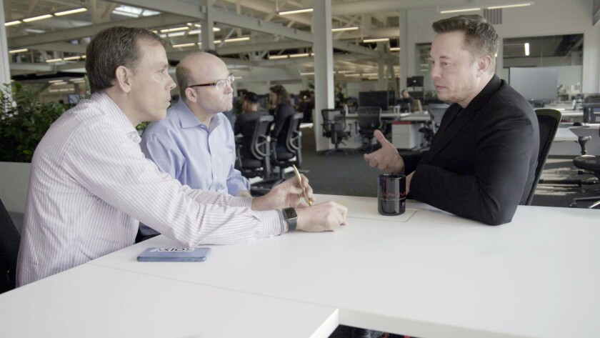 From left, Jim VandeHei and Mike Allen interview Elon Musk for a segment of Axios on HBO. HBO is bri