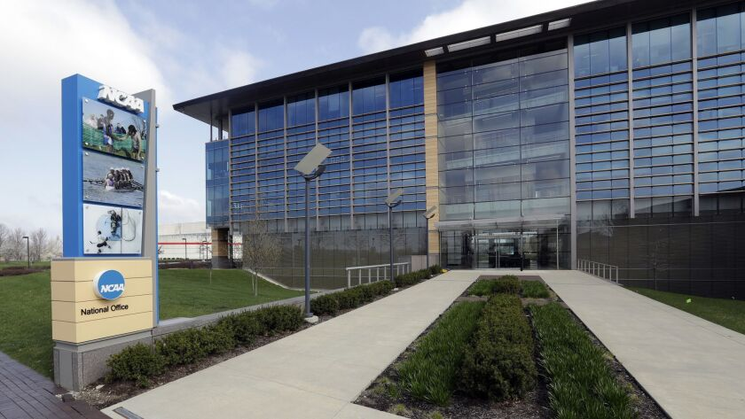 FILE - This is an April 25, 2018, file photo showing NCAA headquarters in Indianapolis. The NCAA has