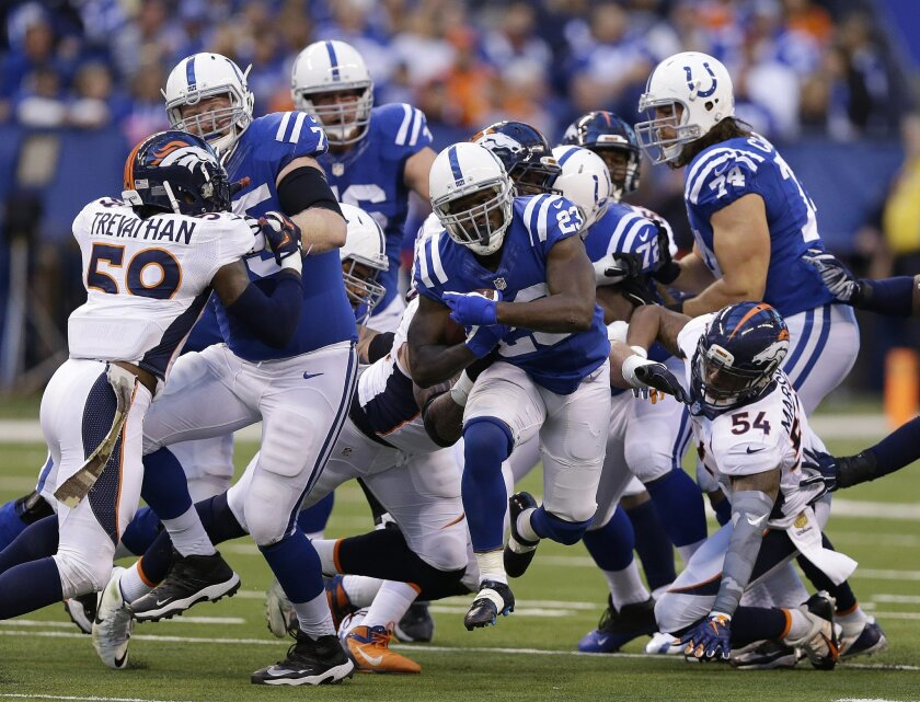 Indianapolis Colts running back Frank Gore (23) runs during the first half of an NFL football game against the Denver Broncos, Sunday, Nov. 8, 2015, Indianapolis. (AP Photo/Michael Conroy)