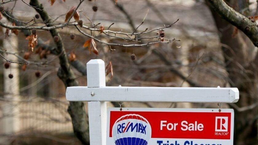 A sign marks a home for sale Jan. 3, 2019, in Franklin Park, Pa. In metro areas long known for affordable home values, the number of homes for sale that a household with a median income could afford has slipped, an analysis says.