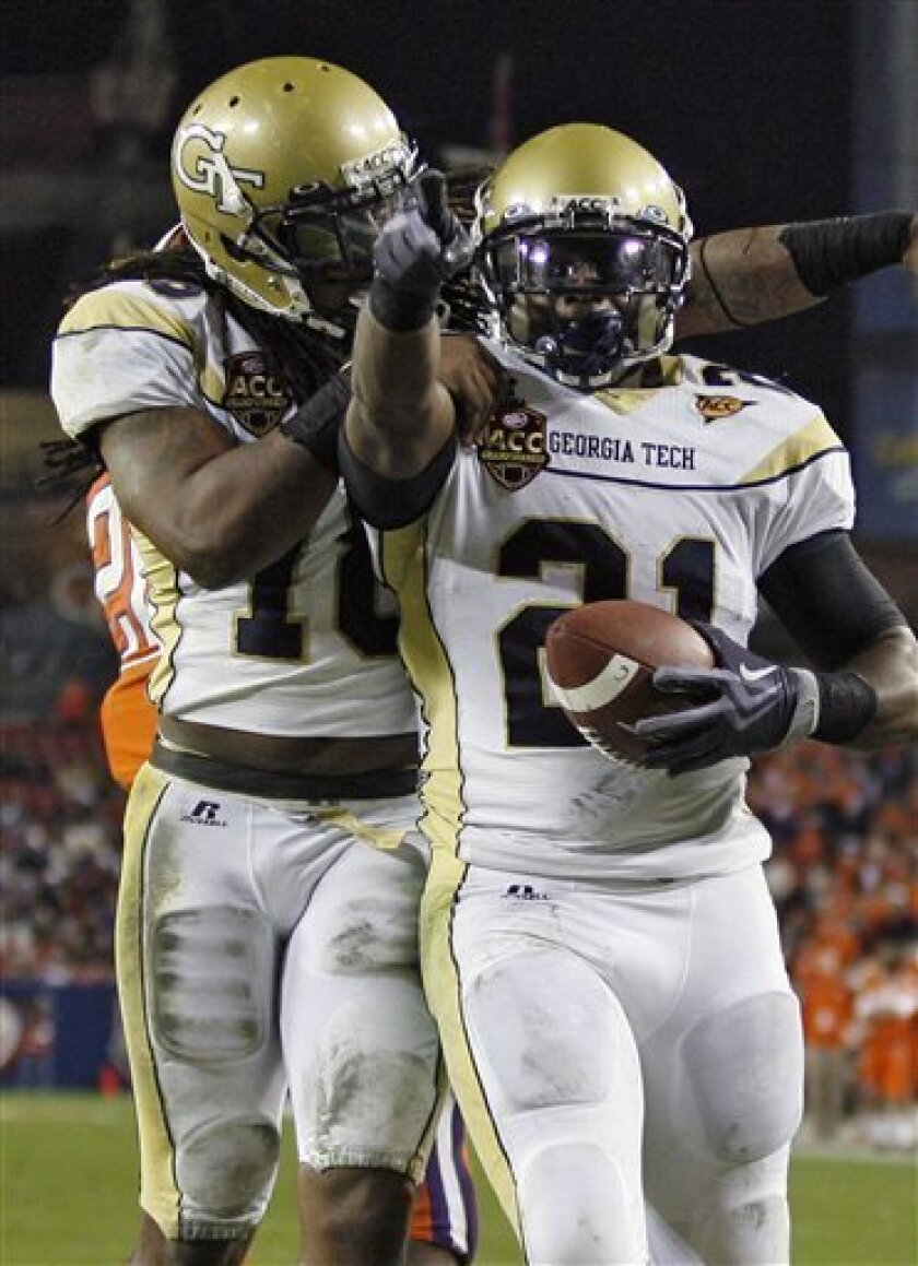 Georgia Tech running back Jonathan Dwyer (21) celebrates with teammate Anthony Allen (18) after scoring a second-quarter touchdown against Clemson during an Atlantic Coast Conference Championship NCAA college football game Saturday, Dec. 5, 2009, in Tampa, Fla. (AP Photo/Mike Carlson)