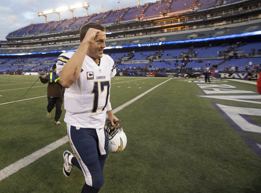 Philip Rivers leaves the field after directing a 34-33 victory over the Baltimore Ravens.