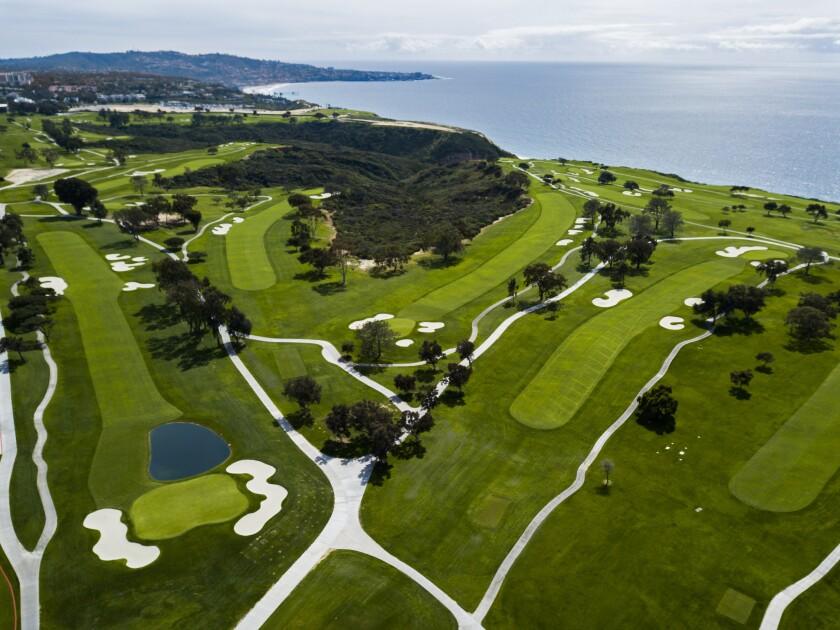 An aerial view of an oceanside golf course.