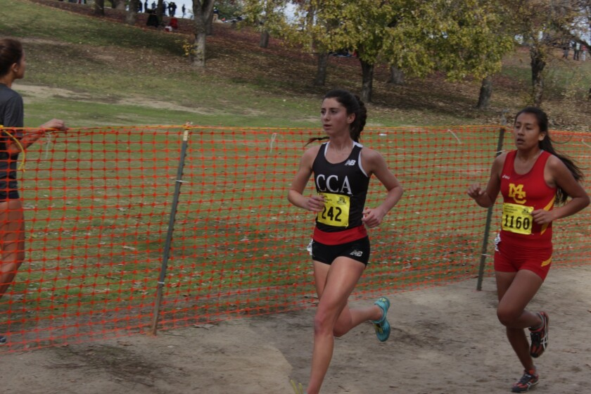 Canyon Crest runner Kira Loren leads the way at the CIF San Diego Section Division II cross country championship on Nov. 19.