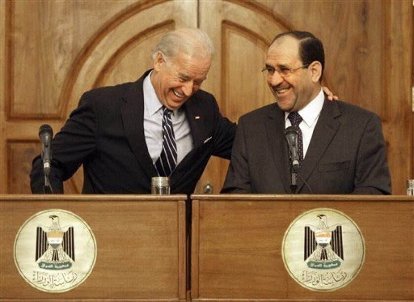 """US Vice President Joe Biden, left, reacts with Iraqi Prime Minsietr Nouri al-Maliki, during a press conference, in Baghdad, Iraq, Wednesday, Sept. 16, 2009. Vice President Joe Biden expressed confidence Wednesday that attempts to destabilize Iraq through violence will fail, and said the country's future depended on its ability to resolve its lingering political and sectarian differences. Meeting with Prime Minister Nouri al-Maliki in his Baghdad office, Biden said the United States was """"committed to the Iraqi government and people as they work to create a peaceful and prosperous Iraq."""" (AP Photo/Hadi Mizban)"""