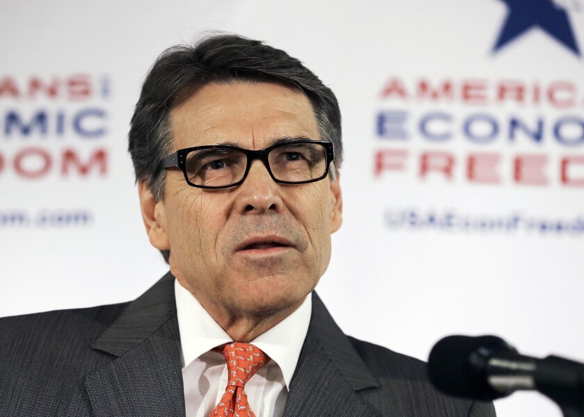 Texas Gov. Rick Perry speaks to reporters at a news conference at the California Republican Party convention in Anaheim on Friday.
