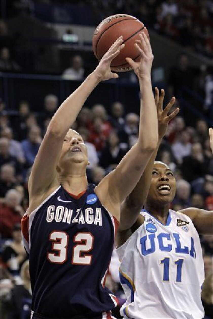 UCLA's Atonye Nyingifa (11) and Gonzaga's Kayla Standish reach for a loose ball during the first half of their second-round game of the NCAA women's college basketball tournament Monday, March 21, 2011, in Spokane, Wash. (AP Photo/Elaine Thompson)