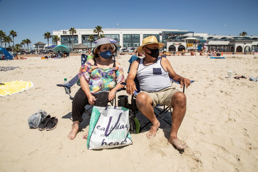 Angelica and Julio Rascon of Tucson visit Mission Beach on Friday.