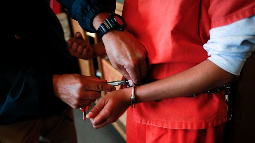 A new arrival has her handcuffs removed after arriving at a girls detention center in Santa Clarita, Calif. on February 27, 2013.