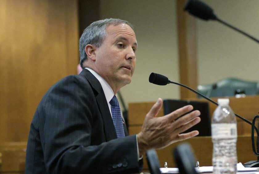 FILE - In this July 29, 2015 file photo, Texas Attorney General Ken Paxton speaks during a hearing in Austin, Texas. Already indicted on felony securities fraud charges, Paxton will face an ethics investigation for advising local officials they could refuse to issue same-sex marriage licenses on re