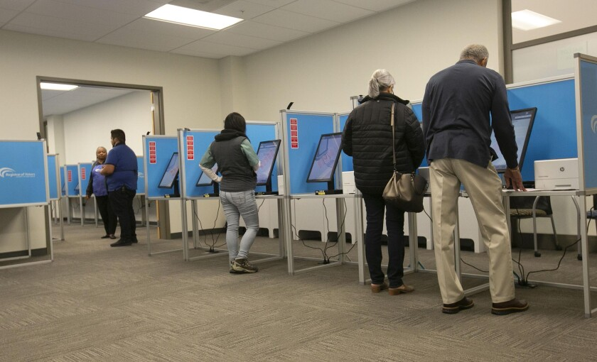 Voters cast ballots in San Diego on Super Tuesday. Washington state, which will hold its primary next week, is asking voters to not lick the envelopes used for mail-in ballots.