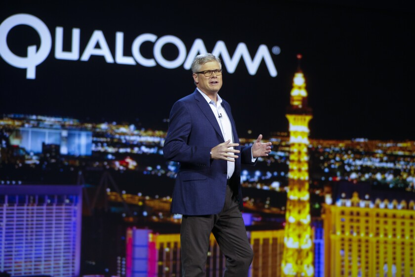 Qualcomm's board of directors awarded CEO Steve Mollenkopf and other executives stock in recognition for successfully settling the long-running legal dispute with Apple.