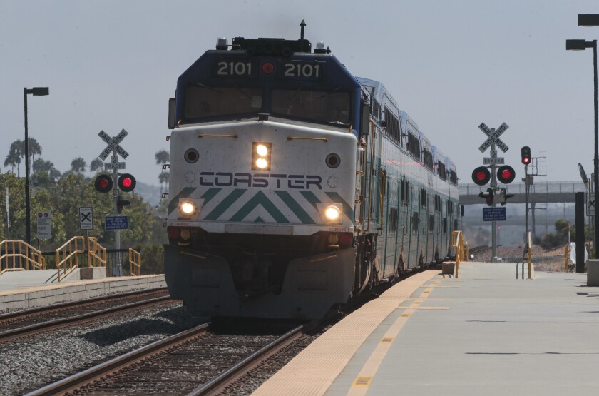 A northbound Coaster train arrives at the Poinsettia station in Carlsbad.