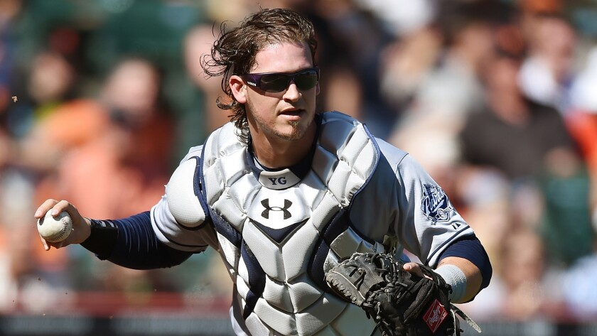 San Diego Padres catcher Yasmani Grandal looks to throw to first base during a game against the San Francisco Giants on Sept. 27. Grandal was acquired by the Dodgers in the trade that sent Matt Kemp to San Diego.