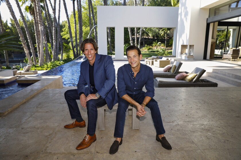 """James Harris (right) is one of the stars of """"Million Dollar Listing: Los Angeles"""" on Bravo TV. He has launched a partnership with Jeff Toth (left) to start selling super-expensive homes in San Diego County. The two are photographed at one of his million dollar properties, in Rancho Santa Fe on Rancho La Cima Drive."""