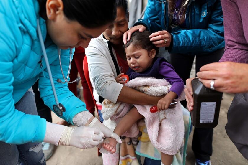 TIJUANA, BAJA CALIF. -- TUESDAY, MAY 1, 2018: Ofelia Castillo Soto, 46, of Michoacan, Mexico, holds