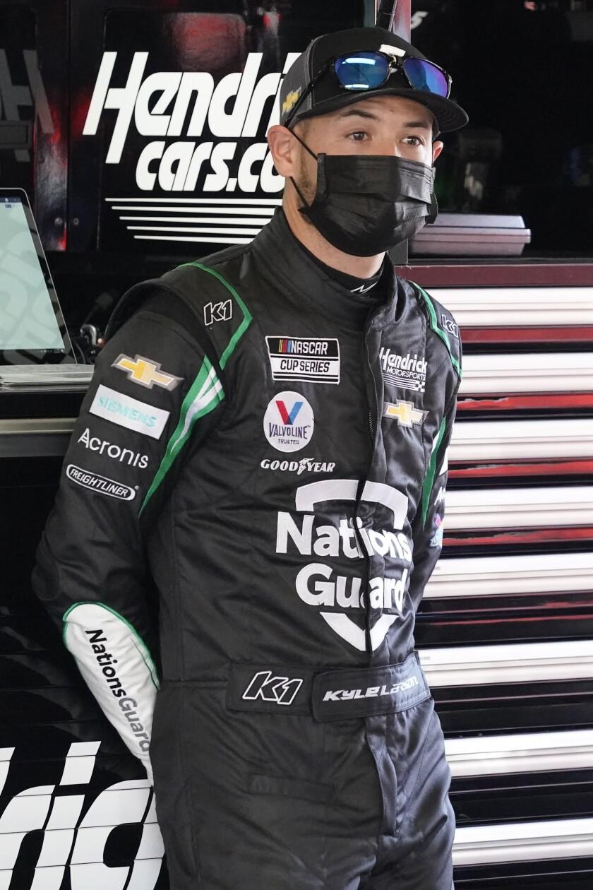 Kyle Larson stands in his garage during a NASCAR Daytona 500 auto race practice session at Daytona International Speedway, Wednesday, Feb. 10, 2021, in Daytona Beach, Fla. (AP Photo/John Raoux)