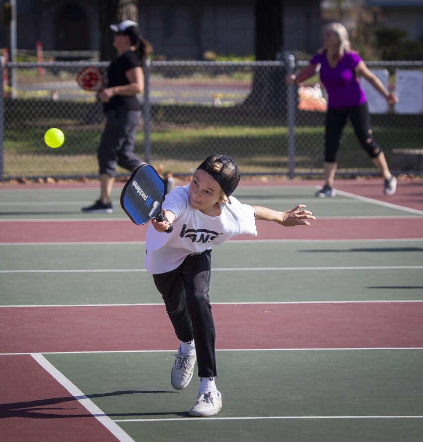 Kids such as Jett Joyner, 13, of Huntington Beach, are picking up pickleball too.