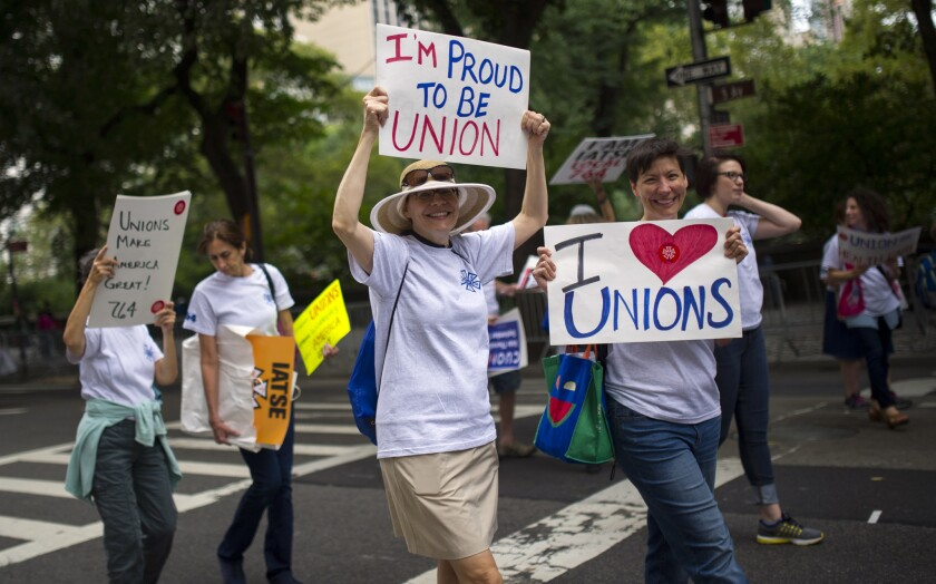 Union workers from all industries and backgrounds made their way up Fifth Ave. Saturday, celebrating the deep roots of organized labor in the Big Apple and making more than a few political statements.