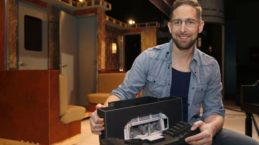 """Scenic designer Sean Fanning with a model of his set for Cygnet Theatre's """"On the Twentieth Century."""""""
