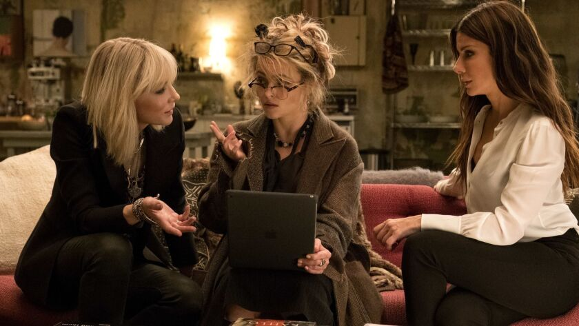 This image released by Warner Bros. shows Cate Blanchett, from left, Helena Bonham Carter and Sandra