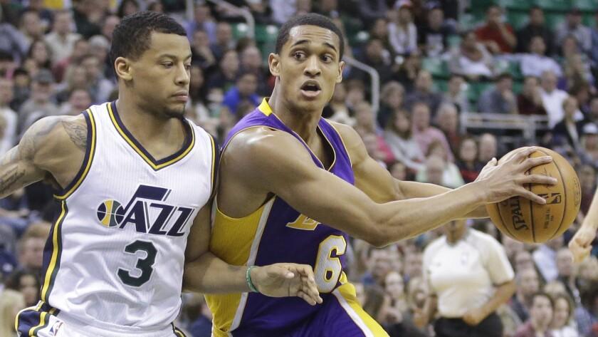 Lakers guard Jordan Clarkson, right, works his way around Utah Jazz guard Trey Burke last season.