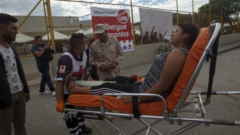 Red Cross paramedics transport a Honduran woman to the hospital after she had an asthma attack in the U.S. border city of Piedras Negras, state of Coahuila, Mexico on Feb. 6.