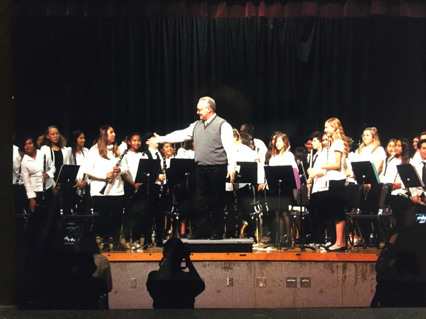 David Fennell photographed last winter with members of the Madison Middle School Mustang Band.